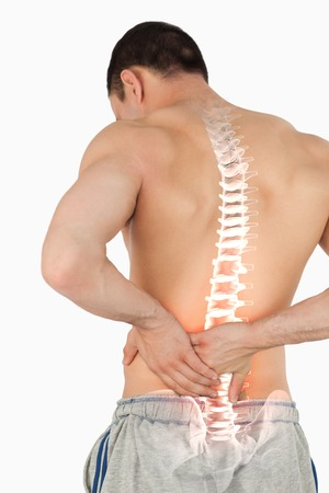 Digital composite of Highlighted spine of man with back pain photo