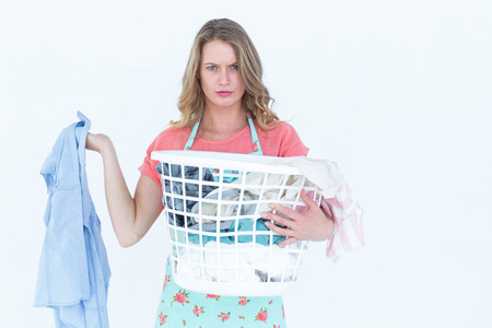 dirty clothes: Woman holding dirty clothes on white background Stock Photo
