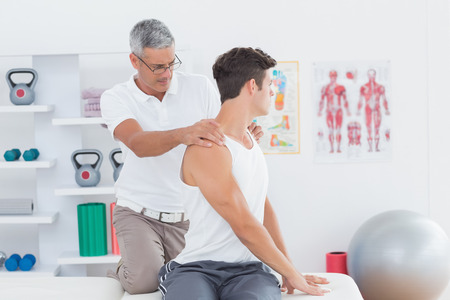 chiropractic: Doctor doing back adjustment in medical office