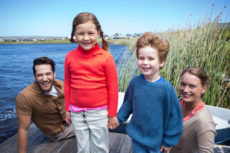 Happy family at a lake in the countryside photo