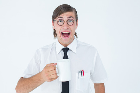 cheesy grin: Geeky businessman holding a mug on white background Stock Photo
