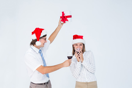 Happy geeky hipster couple drinking red wine on white background photo