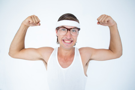 cheesy grin: Geeky hipster posing in sportswear on white background Stock Photo