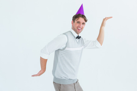 Happy geeky hipster dancing on white background Stock Photo