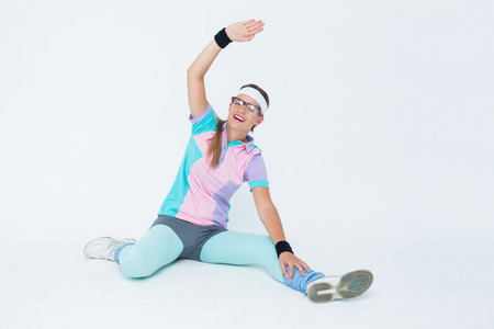 geeky: Geeky hipster posing in sportswear on white background Stock Photo