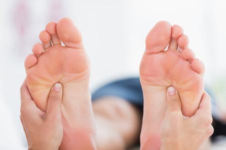 Man having feet massage in medical office photo