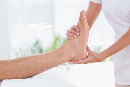 Man having foot massage in medical office photo