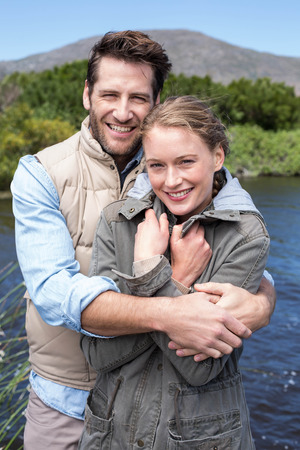 outdoor activities: Happy couple at a lake in the countryside Stock Photo