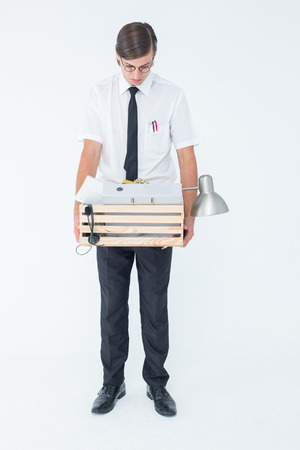 unemployed dismissed: Fired businessman holding box of belongings on white background