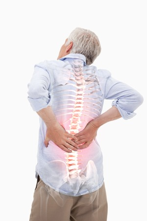 chronic back pain: Digital composite of Highlighted spine of man with back pain