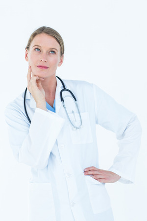 white work: Thoughtful doctor thinking about work on white background Stock Photo
