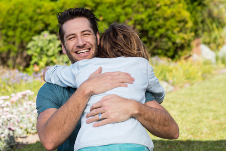 Father and son hugging in the countryside