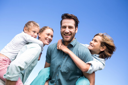 summer activities: Happy parents with their children in the countryside Stock Photo