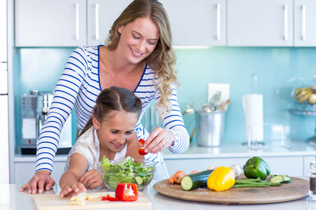 healthy life: Happy family preparing lunch together at home in the kitchen Stock Photo
