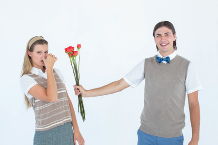 together with long tie: Geeky hipster offering red roses to his girlfriend on white background Stock Photo