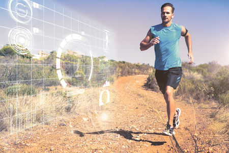 tracking: Athletic man jogging on country trail against fitness interface Stock Photo