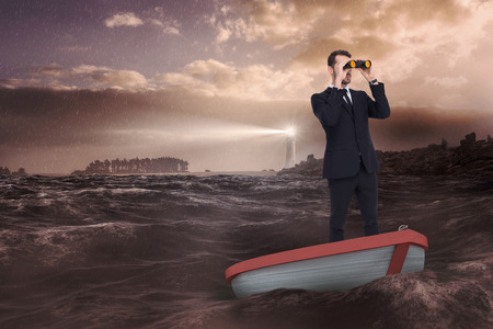 stormy sea: Businessman in boat with binoculars against stormy sea with lighthouse