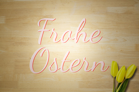 Ostern: Yellow tulips against frohe ostern Stock Photo
