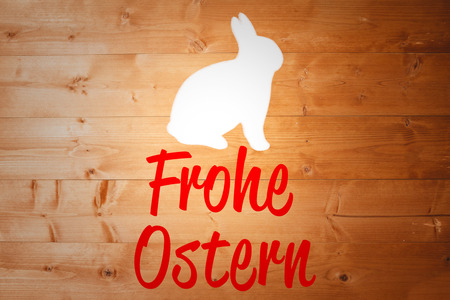 Ostern: bunny outline against frohe ostern Stock Photo