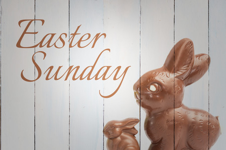 easter sunday: easter sunday against big and small chocolate bunny rabbits
