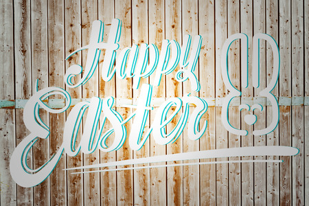 pale wood: happy easter against wooden background in pale wood Stock Photo