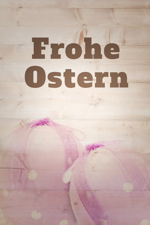 Ostern: frohe ostern against easter egg with ribbon Stock Photo