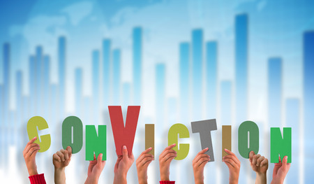 conviction: hands showing conviction against global business graphic in blue Stock Photo
