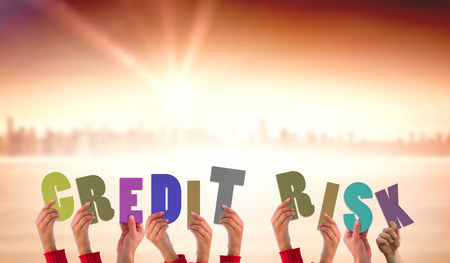 credit risk: Hands holding up credit risk against sun shining over city