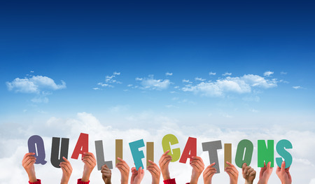 qualifications: Hands holding up qualifications against bright blue sky over clouds Stock Photo