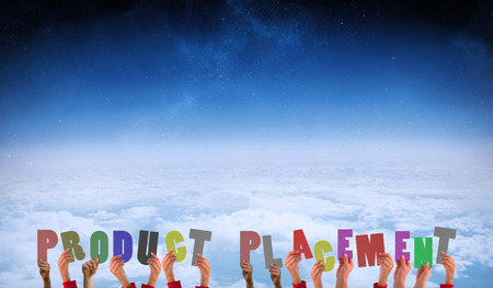 product placement: Hands showing product placement against white clouds under blue sky