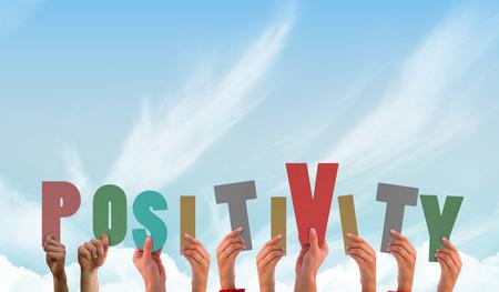 positivity: Hands showing positivity against blue sky