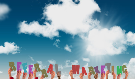 referral marketing: Hands showing referral marketing against blue sky Stock Photo