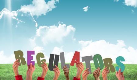 regulators: Hands holding up regulators  against field and sky