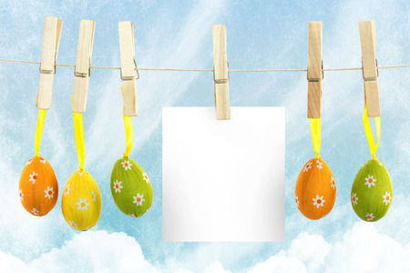 confectionary: hanging easter eggs against painted blue sky