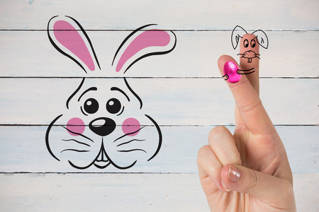 floorboard: Fingers as easter bunny against painted blue wooden planks