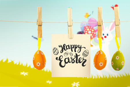 pegs: Happy Easter greeting against easter bunny with eggs Stock Photo