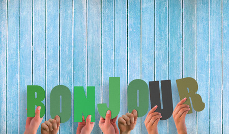 bonjour: Hands holding up bonjour against wooden planks Stock Photo