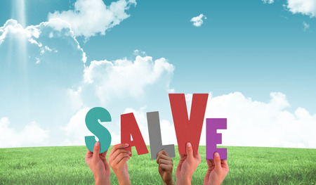 salve: Hands holding up salve against field and sky Stock Photo