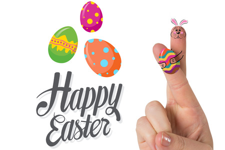 easter sunday: Fingers as easter bunny against happy easter