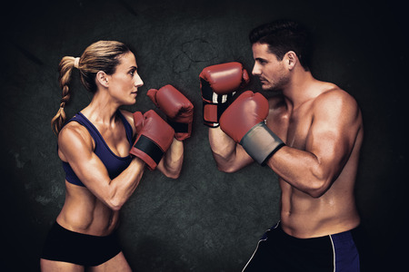 woman boxing gloves: Boxing couple   against dark background
