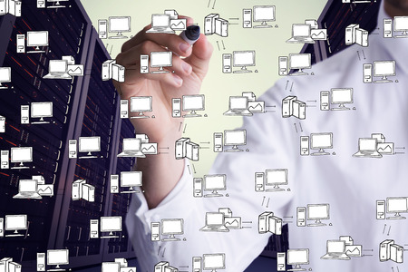 Mid section of businessman writing with marker against cloud computing doodle photo