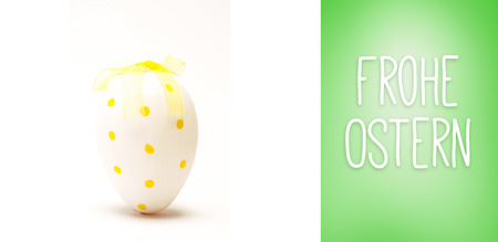 Ostern: Frohe ostern against green vignette Stock Photo