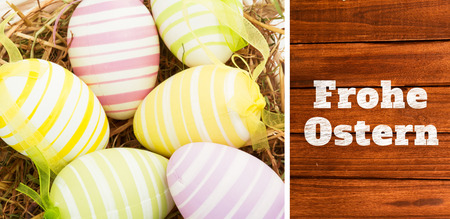 Frohe ostern against overhead of wooden planks photo