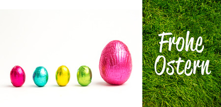 Ostern: Frohe ostern against grass background Stock Photo