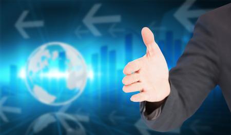 extending: Businessman extending arm for handshake against global business graphic in blue