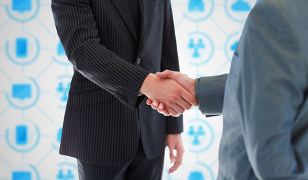 coalition: Business people shaking hands against app interface Stock Photo