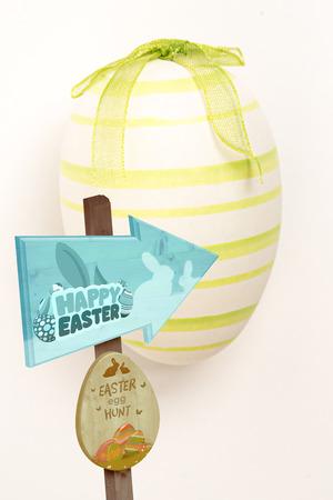 green hand: Easter egg hunt sign against green hand painted easter egg