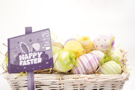 Easter egg hunt sign against many colourful easter eggs in basket photo