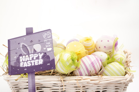 Easter egg hunt sign against many colourful easter eggs in basket photo