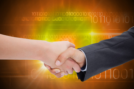 up code: Close up of a handshake against blue technology design with binary code